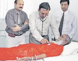 Prahlad Jani, a famous Indian breatharian, here being inspected by a medical team. There has been a long controversy in India over his professed ability to live without food and water for 70 years.